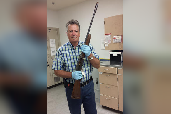 Seattle police cold case Detective Mike Ciesynski is shown holding Cobain's gun at different angles in five photos posted to the police department's website. (PHOTO: Seattle Police)