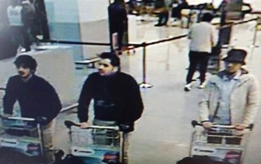 Khalid and Ibrahim El Bakraou are seen dressed in black at Brussels Airport on Tuesday along with suspect Najim Laachraoui, right, who remains on the run.