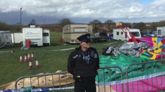 Two arrests have been made in Britain after a seven-year-old girl died while using a bouncy castle at an Easter fair.