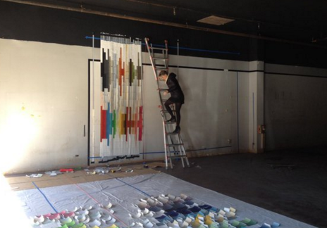 Artists are working to beautify vacant lots downtown - the art goes in the windows of businesses.