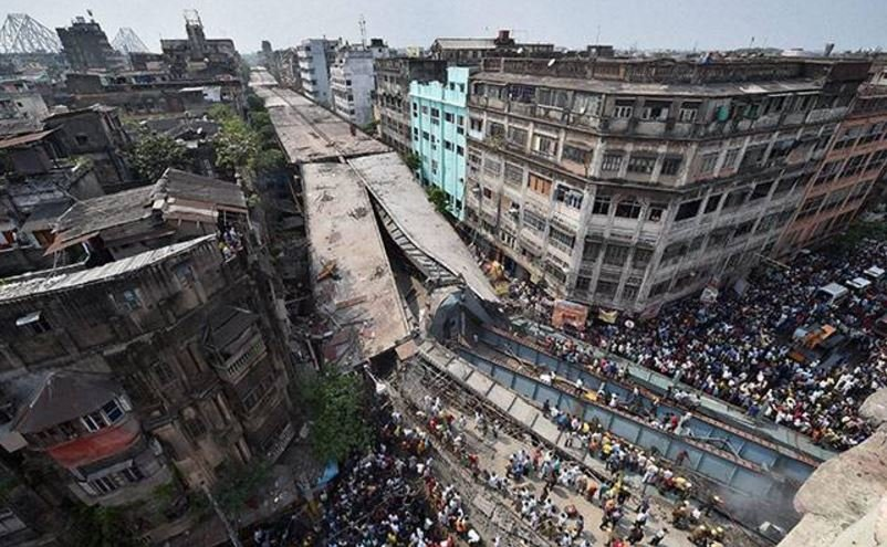 An overpass stretching more than 1.2 miles in Kolkata, India collapsed on Thursday, trapping cars, street vendors and pedestrians.  15 are confirmed dead, more than 150 are missing.