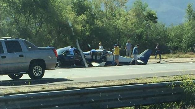 Authorities say a small plane has crashed on a Southern California freeway and struck a car, killing one person and injuring five others. Photo: Cara Starkweather