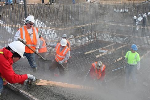 Workers pouring concrete to form the deep end of Shadle Pool. Courtesy Spokane Parks & Rec