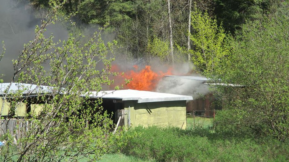 Photo of the shed burning from the Shoshone County Sheriff's Office