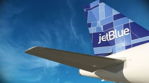 A commercial pilot was under the influence of alcohol while flying a JetBlue airliner carrying 151 passengers last year from Orlando to New York City, federal prosecutors said Wednesday.