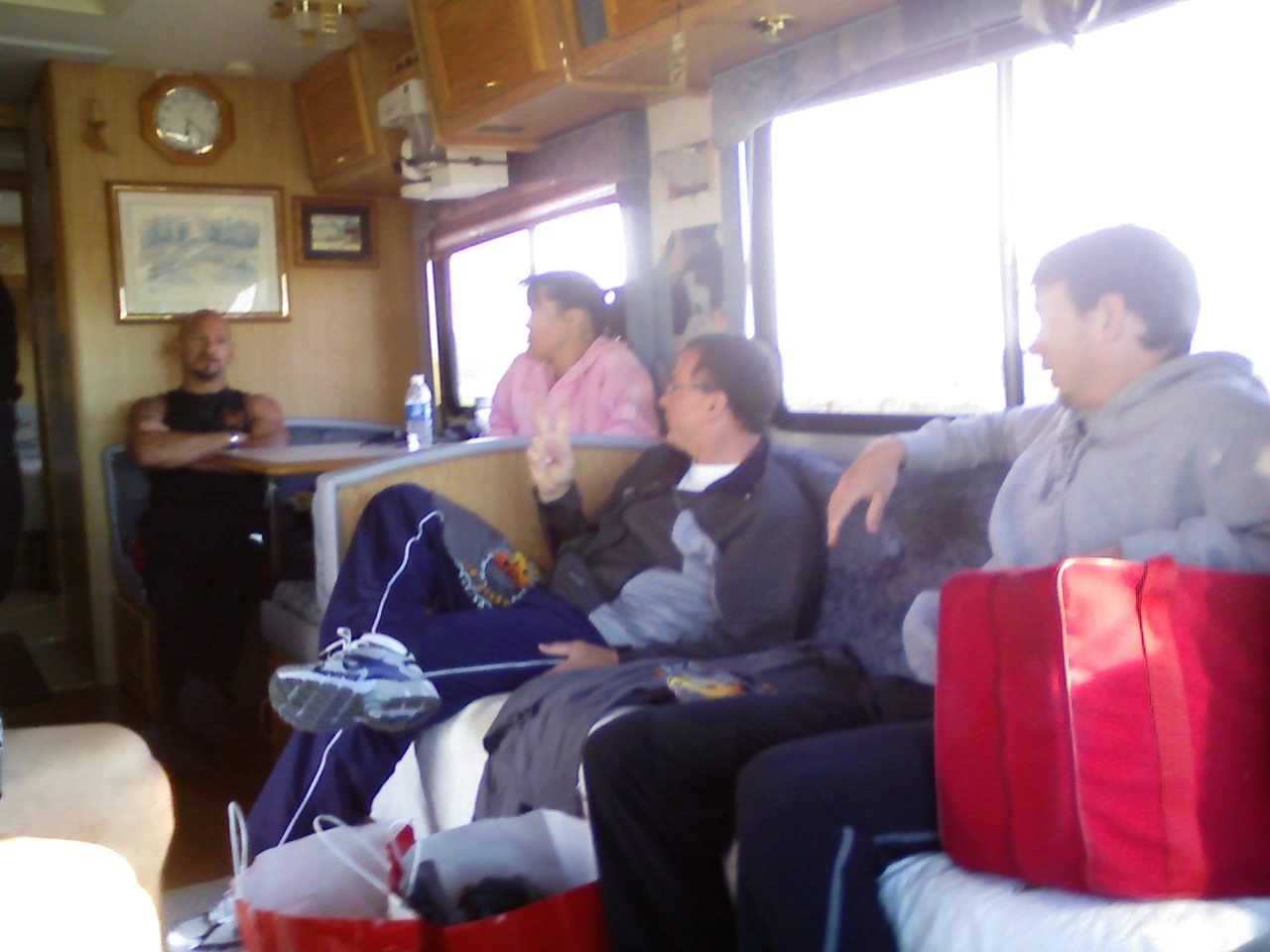 Onboard the Torch Run relay bus with the runners awaiting their turn