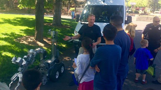 A police officer shows kids the explosive disposal robot
