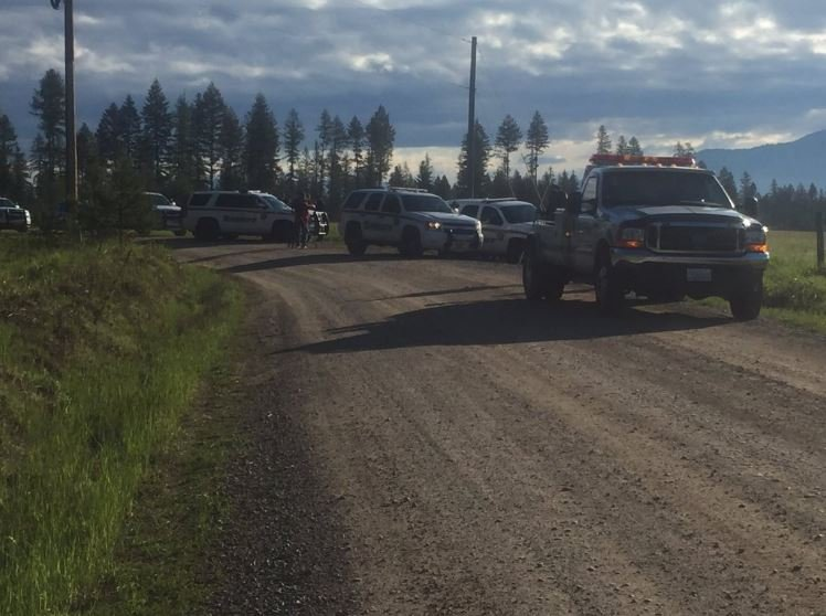 The scene at Elmers Loop and Spring Valley Rd. as the Pend Oreille County Sheriff's continues to search for two armed suspects who shot at police overnight during a chase, then ditched their car and fled on foot.