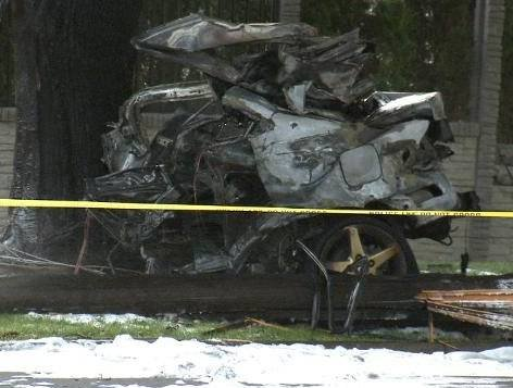 The back portion of the Acura following impact with the tree