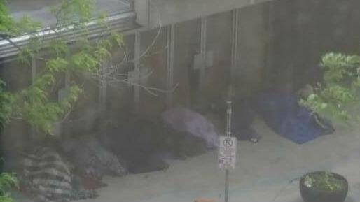 Homeless people camped outside Spokane Macy's