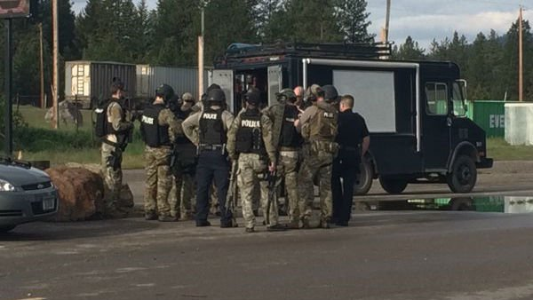 Police in Missoula are searching for two men who reportedly robbed a casino, took a family hostage and fired shots at pursuing officers before finally freeing the hostages and fleeing on foot.
