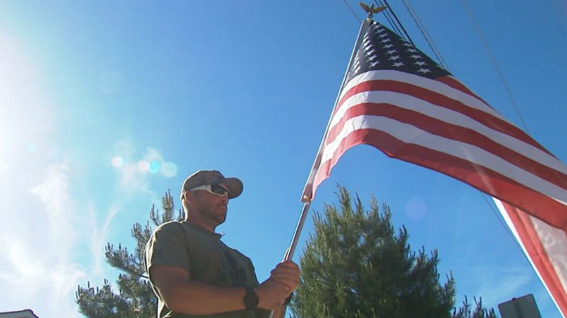 Shaun Key held his flag for nine hours Monday