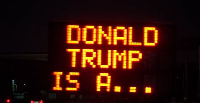 Electronic construction signs in the Dallas area appear to have been hacked, displaying messages calling Donald Trump a reptile and imploring early morning commuters to take a day off work.