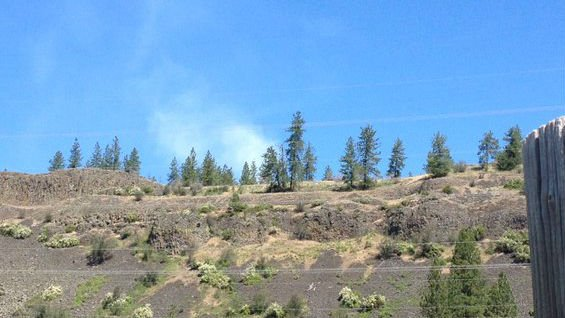 Smoke from a brush fire burning off Four Mounds Tuesday