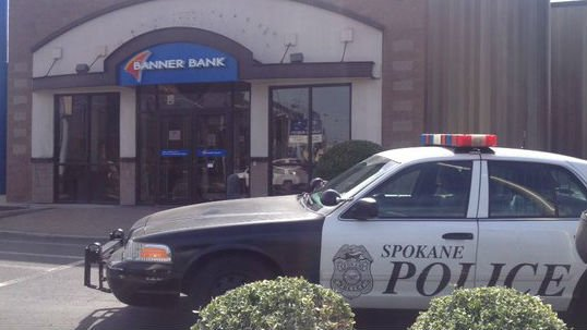 The scene of a bank robbery in Spokane Wednesday.