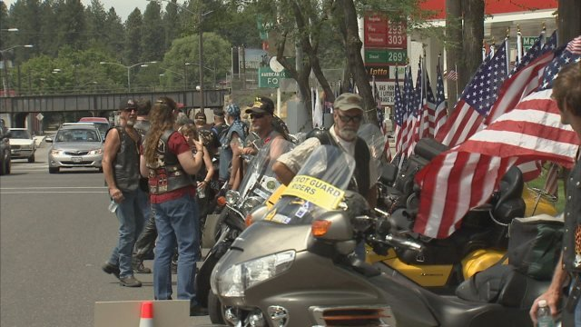 Members of the Patriot Guard lined 3rd Ave. in Spokane all day Sunday as buses drove veterans from the airport