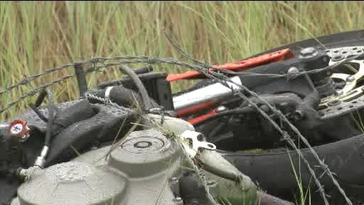 Spencer's motorcycle was discovered wrapped in barbed wire from the fence he struck