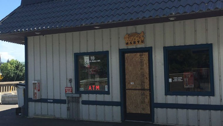The door robbers smashed is now boarded up