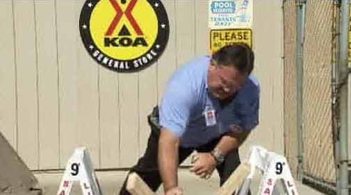 Wrestler demonstrates breaking a board for KHQ