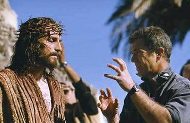 Mel Gibson talking with Actor Jim Caviezel on the set of Gibsons controversial film 'The Passion of the Christ'