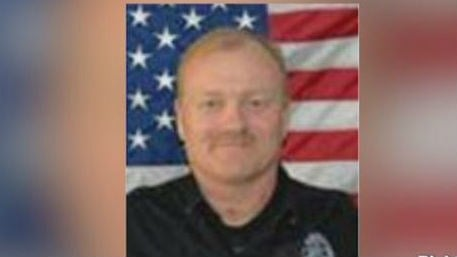 Officer Robert Dressel saved a man in the water.