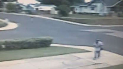 Surveillance video shows the fake mailman
