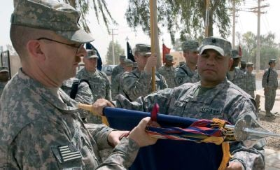 Lt. Col. Gregory J. Allen, 1st Battalion, 161st Infantry Regiment and Command Sgt. Maj. David Windom, both of Spokane, Wash., encase their unit's colors during a transfer of authority ceremony at Joint Base Balad, Iraq July 29.