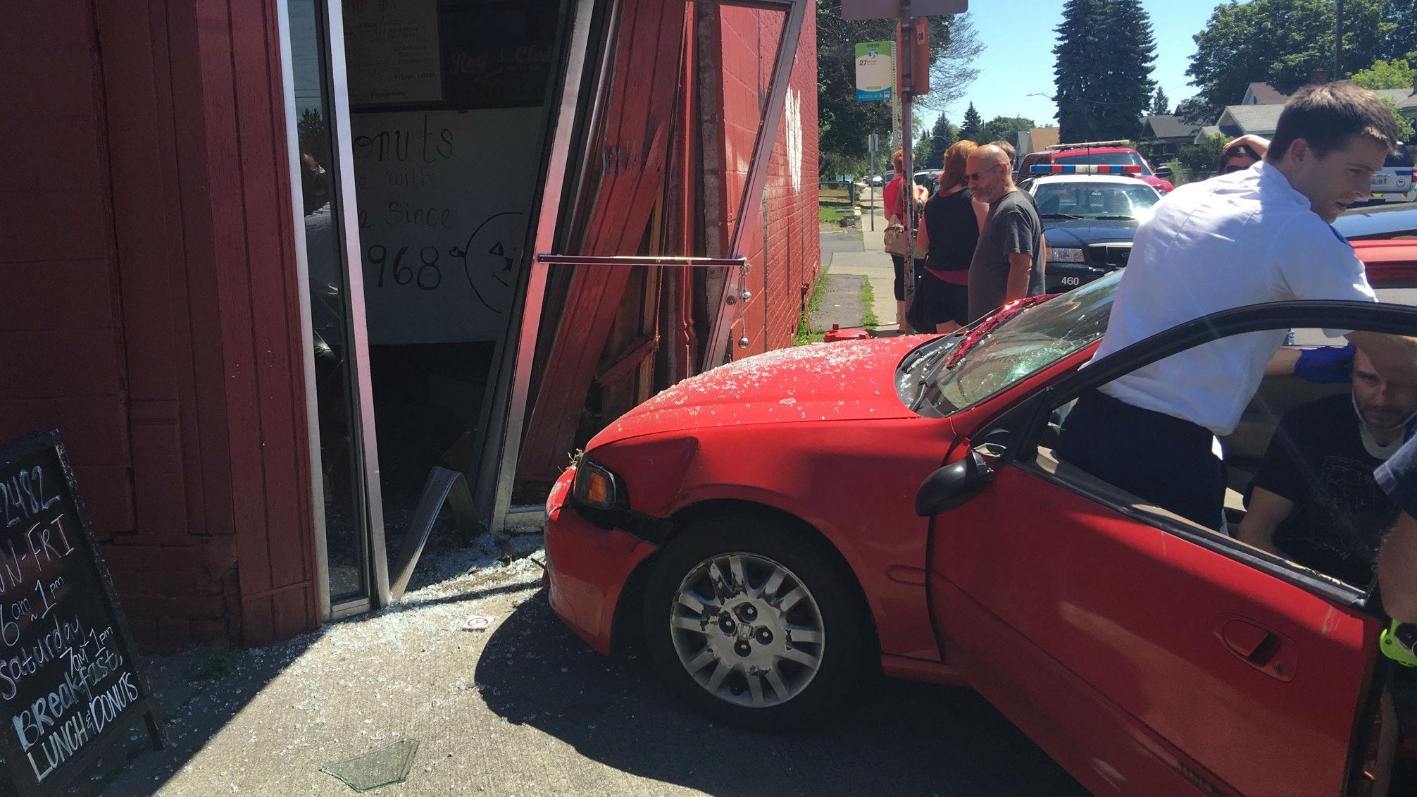 A car crashed into The Donut Parade Tuesday morning (PHOTOS: Alexandria Bown)