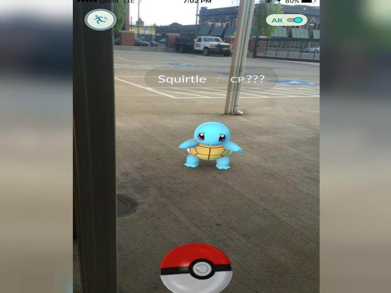 A wild Squirtle appears in the KHQ parking lot! (Screenshot from Pokemon Go on iPhone)