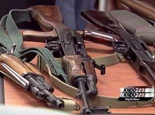 (Above and Below) Guns confiscated during gang and narcotics sting operations