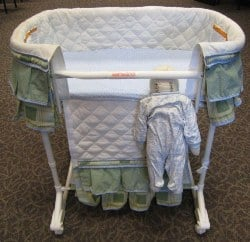Doll shows how child can be caught and strangled in bassinet
