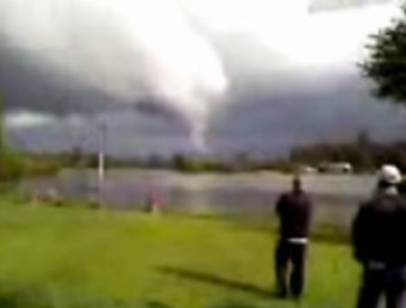 Still image taken from viewer cell phone video shows what appears to be a tornado touching down