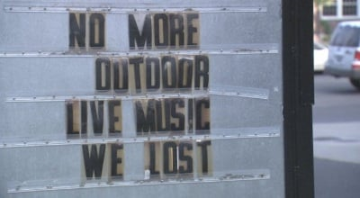 Sign outside Rocket Market after the ban on live music was instituted