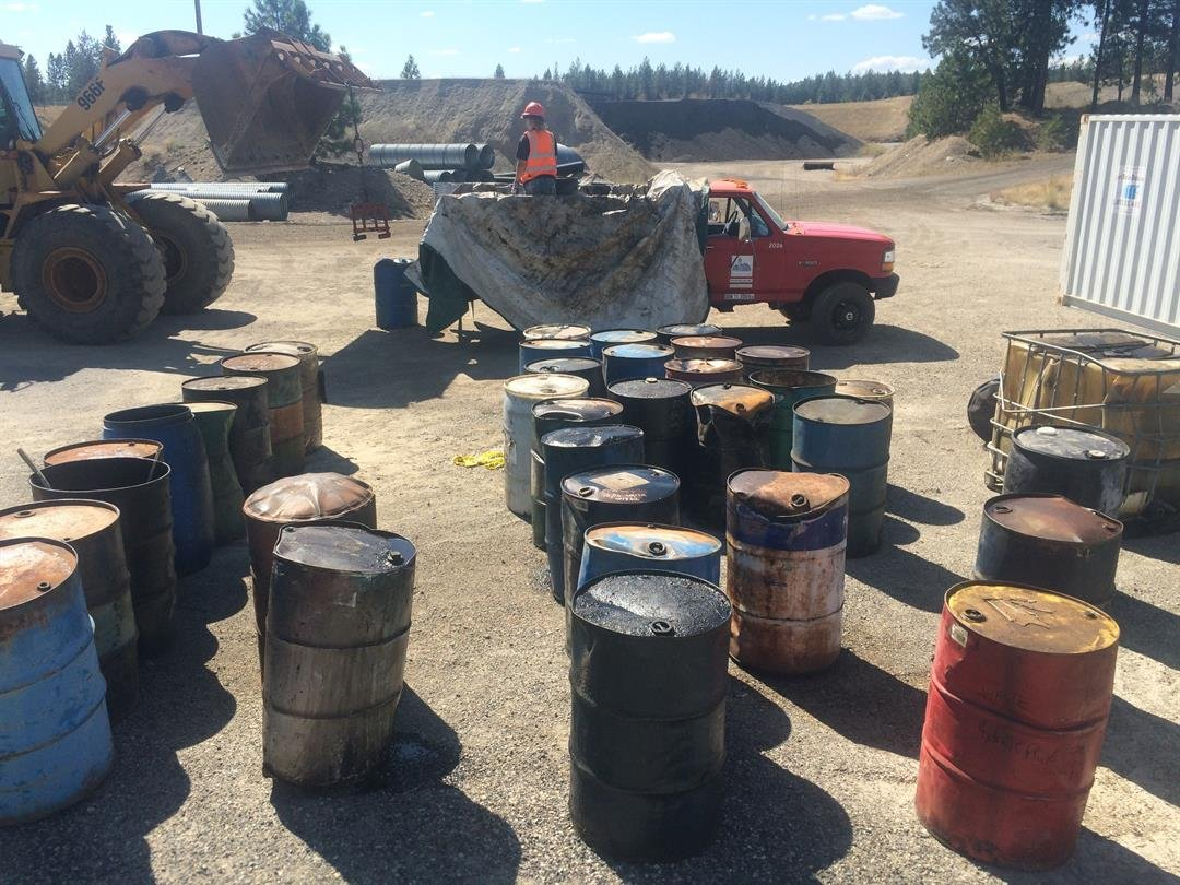 Some of the barrels are empty, but the majority of them are filled with used motor or hydraulic oil.