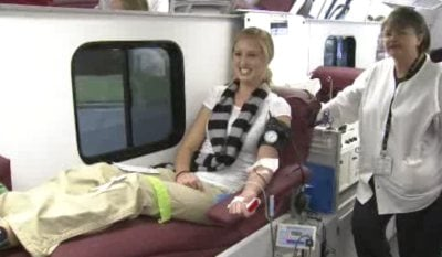 A Valley Christian student donates blood during Monday's blood drive held in honor of football player Drew Swank