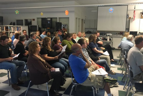 A school board meeting following McCoy's administrative leave was packed with parents.