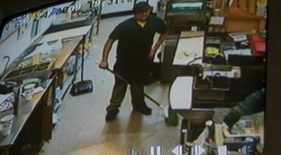 Luis, a Quiznos employee, had basically no reaction to the suspect's demand for cash