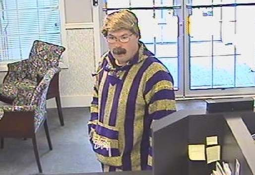 A man wearing a gold wig robbed the Inland Northwest Bank near Hawthorne and Nevada after using duct tape to bind bank employees