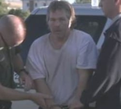Phillip Paul is taken into custody