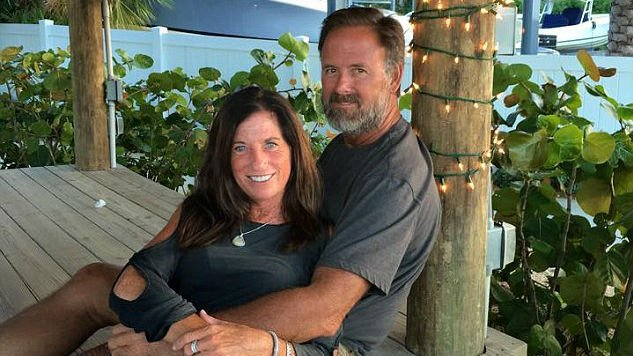 The 19-year-old college student is accused of stabbing to death Michelle Mishcon, 53, and her husband, John Stevens III, 59 (pictured together) before reportedly biting pieces of flesh off of the man's face  (PHOTO: Facebook)