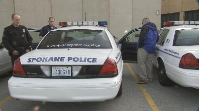 Members of the SPD Honor Guard prepare to leave Spokane for Seattle Thursday morning