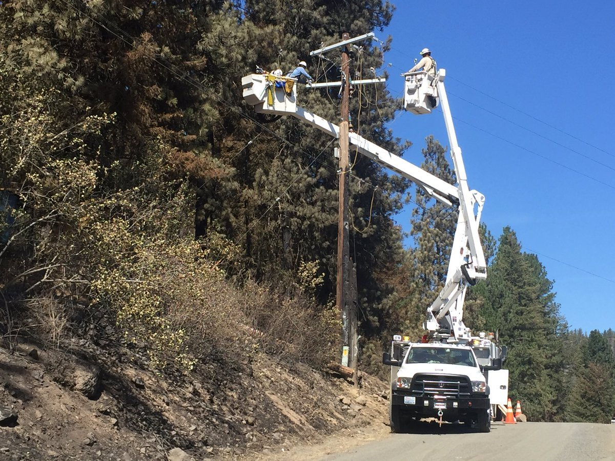 As crews watch for hotspots, others are restoring power to homes that survived.