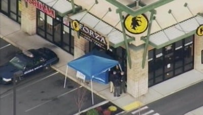 Three male officers and one female officer were killed when the shooter opened fire in this 'Forza' coffee shop
