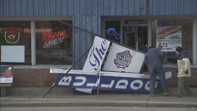 Gusting winds blew the Bulldog Tavern's sign down Sunday