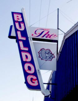 The Bulldog Tavern sign used to sit atop the landmark business before Sunday's wind gust blew it down