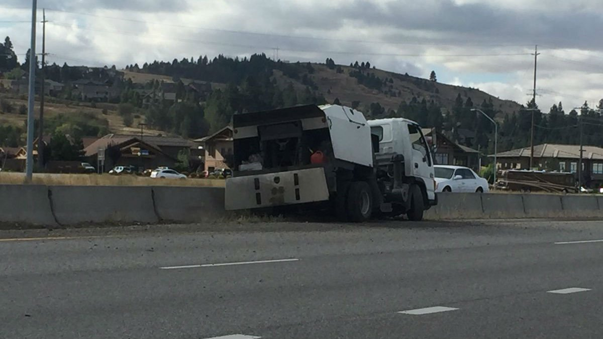 WSP says this sweeper may have been changing lanes, causing another car to quickly swerve and hit the overpass.