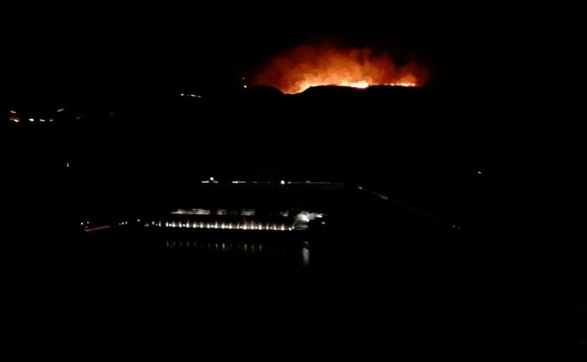This photo shows the 230 Yard Fire burning abover Grand Coulee Dam. Courtesy - Mike Campbell