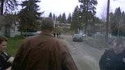 Sgt. Dave Reagan looks on as officers investigate the shooting on Spokane's south side Friday morning (Photo: KHQ)
