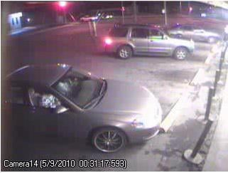 SUV (upper center) and sedan (lower left) believed to be involved in shooting
