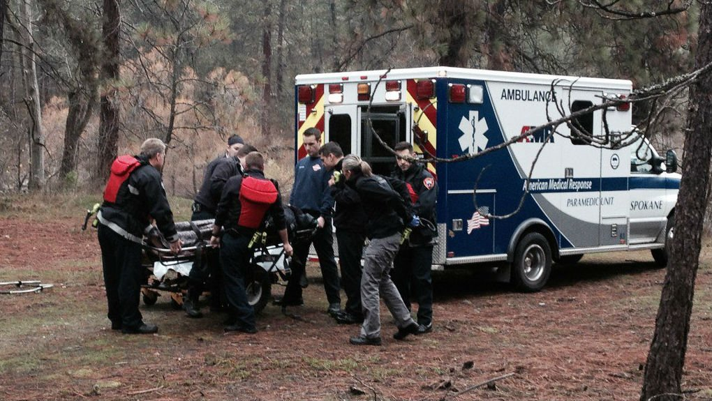 Firefighters pull a man out of the Spokane River